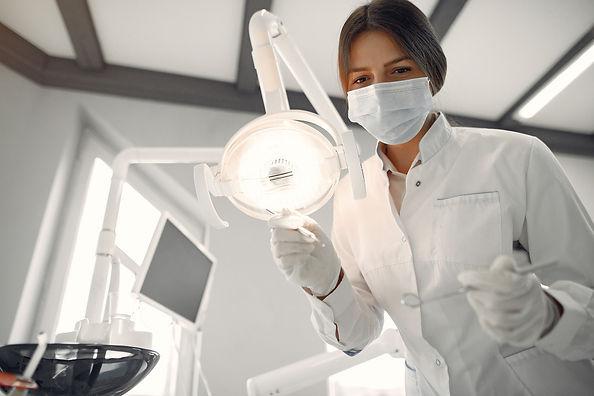 beautiful-dentist-working-on-a-dental-cl