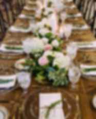 Wedding table setting rental with farm table and chargers