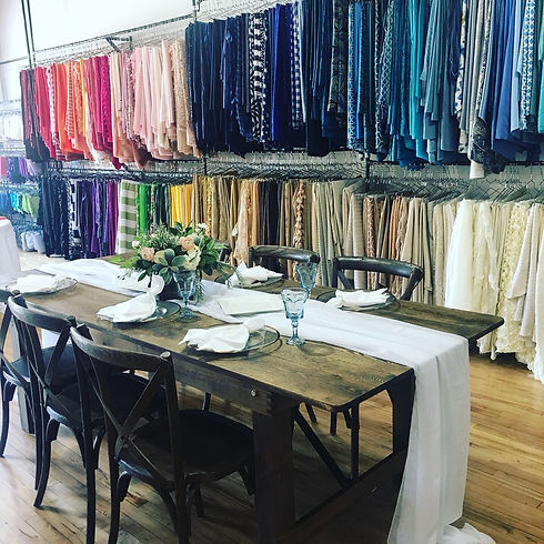 Wedding and party rental showroom with farm table