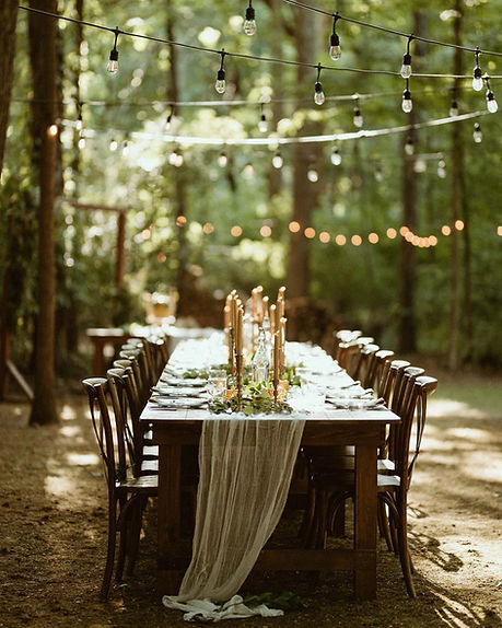 Farm table and farm chairs in backyard for wedding reception