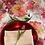 Red Charger Rental on Spring Blossom Table Linen