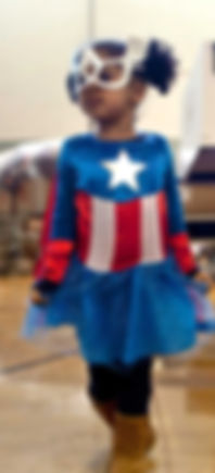 young girl with superhero costume