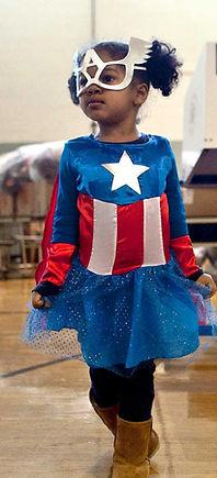 young girl with superhero costume