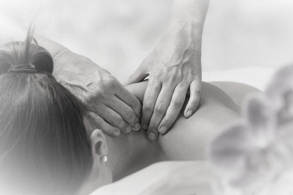detail-of-hands-massaging-female-neck-pi