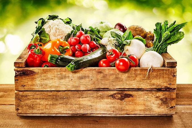 Wooden crate of farm fresh vegetables wi