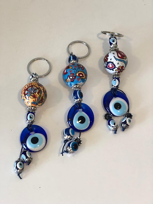 ASSORTED EVIL EYE CHRISTMAS ORNAMENTS, 50 pieces