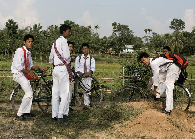 High School students with their bikes come out of their school