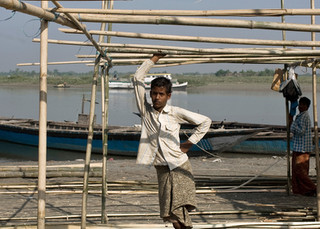 Bangladeshi migrants work with bamboo trees to make various household items in Dhubri