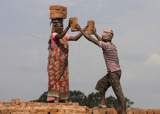 Bangladesh migrants work at the brick factory livings in the town of Dhubri, State of Assam in India