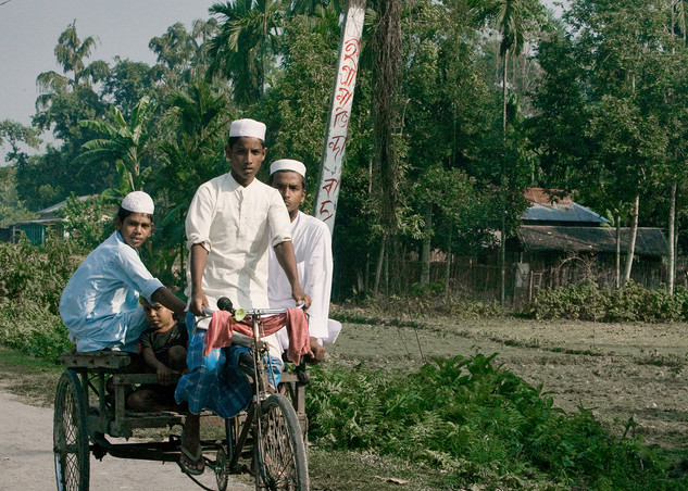 Muslim youth rides towards Madrassa in Dhubri. Dhubri's 75 percent of the population follows Islam.