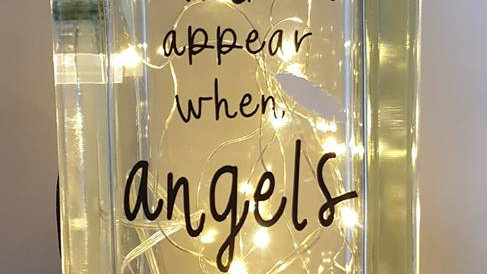 Feathers appear when angels are near light block