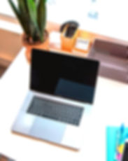 macbook%20pro%20on%20white%20table_edite