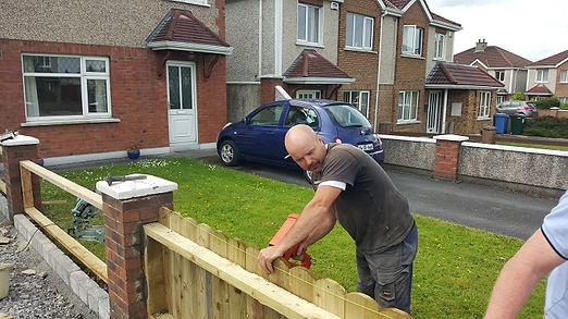 round top picket fence under construction by flannery and sons Landscaping
