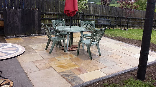 mint sandstone patio with brick surround