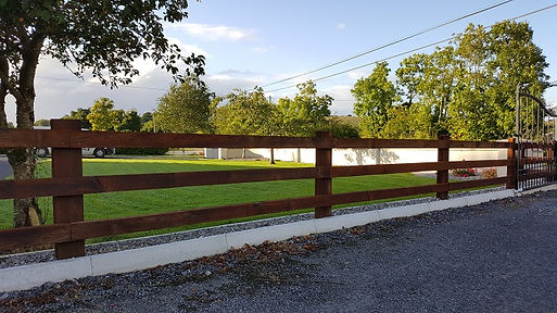cresote post and rail timber fence