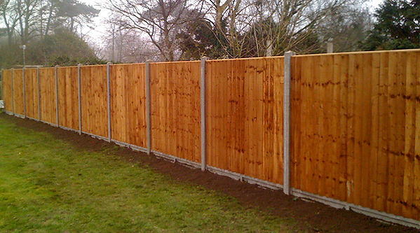 concrete post and timber panel fence