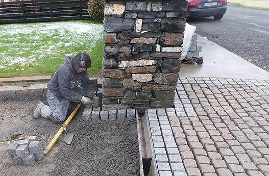 Laying granite setts.