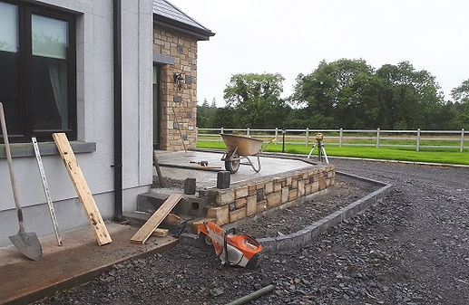 Limestone patio under construction by flannery and sons landscaping