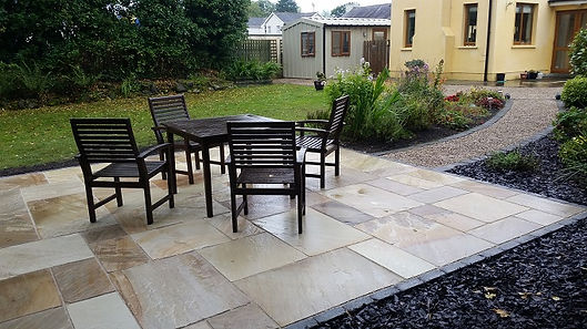 this is a picture of a sandstone patio under construction by flannery and sons landscaping
