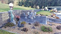 Large limestone patio area with brick surround