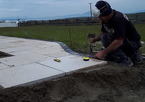 laying granite paving.jpg