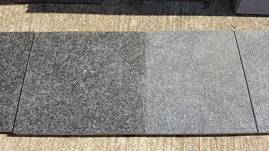 The dark grey/black colour naturally tones down as the product weathers to a stylish graphite grey.  We ask customers to consider using a preparatory stone impregnator to ensure the dark colour is maintained, should the material be left uncoated the stone weathers and lightens.