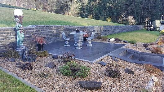Picture of a black limestone patio area