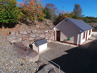 Rock building by Flannery and sons Landscaping.