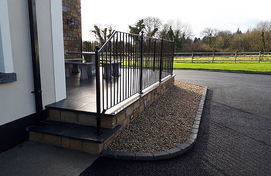 limestone steps with steel hand rails
