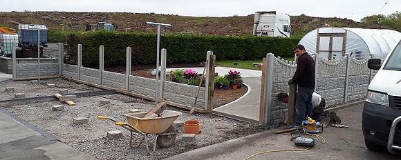 concrete panel fence under construction