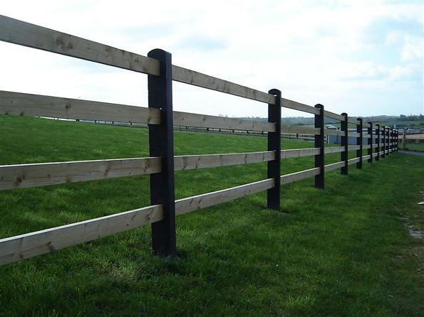 concrete post and timber rail fence