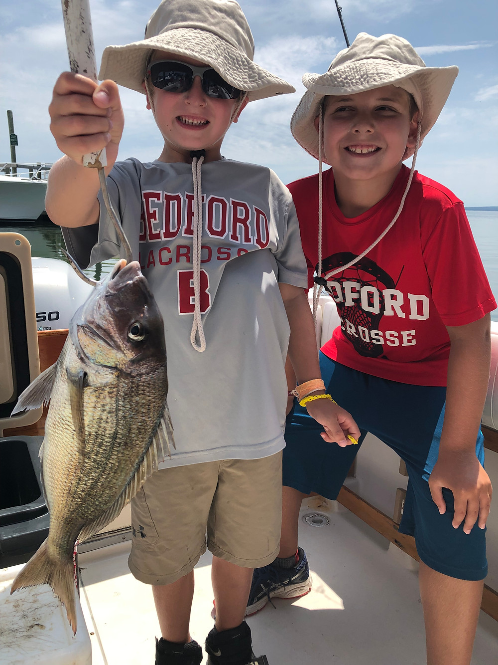 Niko and brother Rocco with a large Porgy