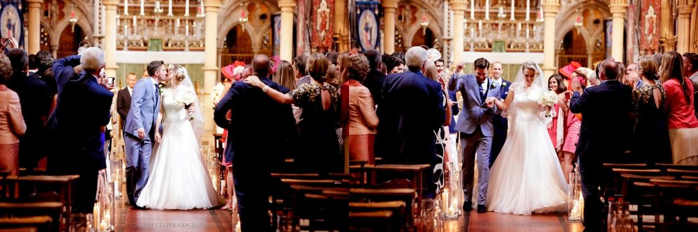 The bride and groom danced down the aisle after their wedding.