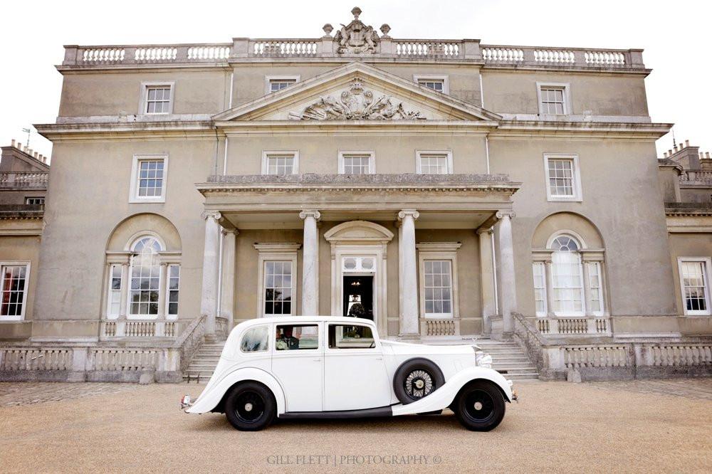 Bride and Groom arrive at Wrotham Park, Hertforshire , in a vintage Rolls Royce.
