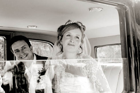 vintage-car-wedding-couple-leaving-churc