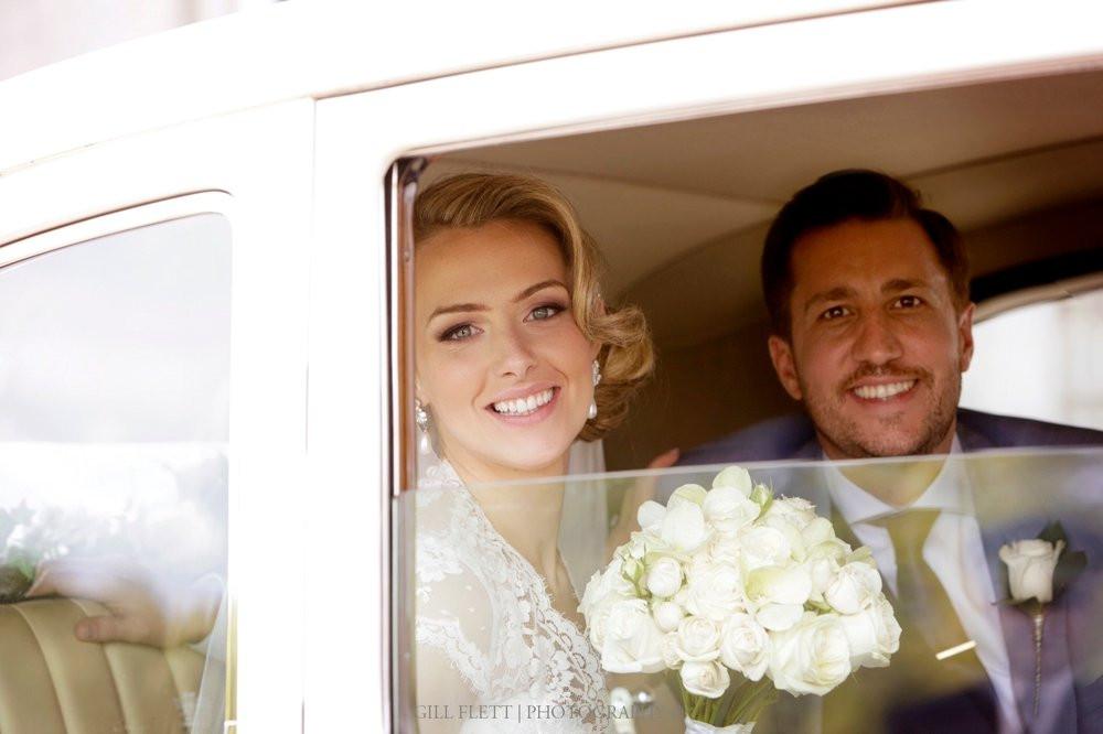 Bride and Groom in a Vintage Rolls Royce.