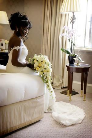 dorchester-wedding-bride-sitting-on-bed_