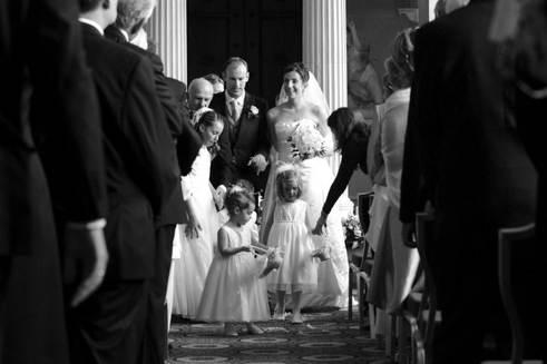 bride-and-groom-down-aisle-woburn-abbey.