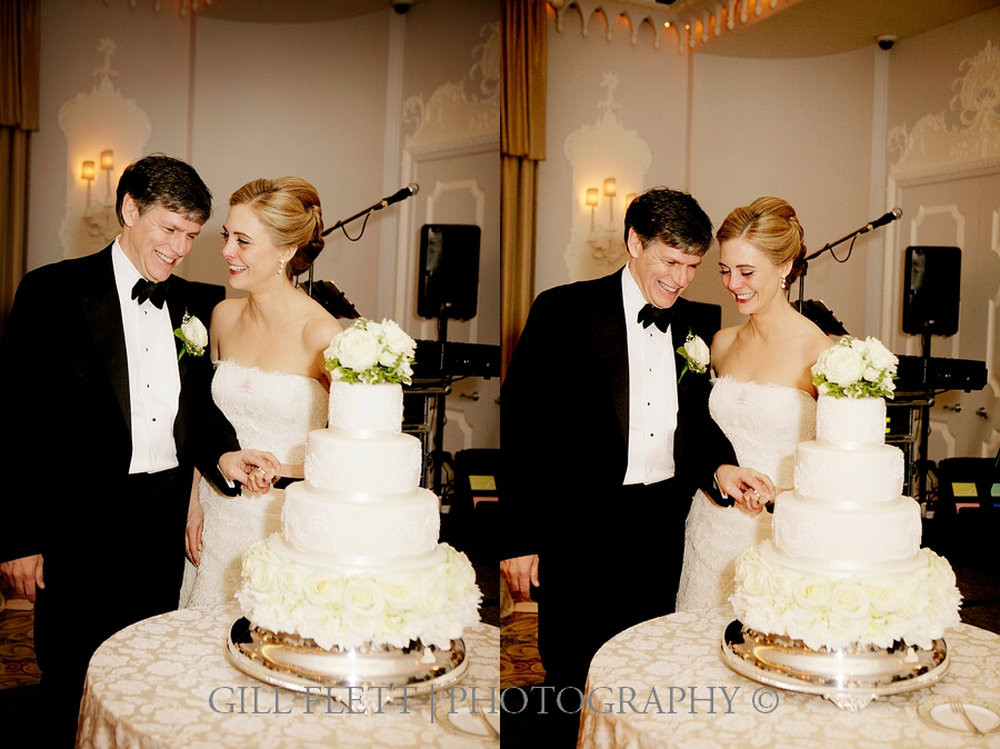 The bride and groom cut their wedding cake in The Orchid Room