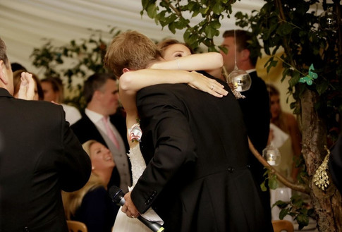 bride-hugging-groom-after-speeches-marqu