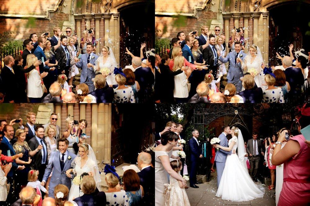 Bride and Groom leaving wedding ceremony through confetti.