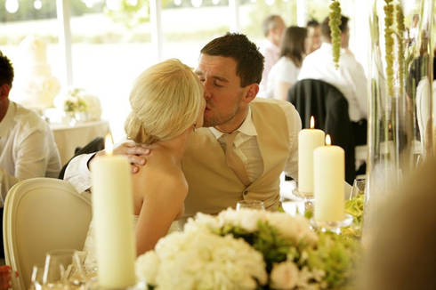 kiss-during-dinner-surrey-wedding_0183.j
