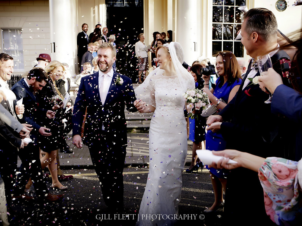 Throwing Confetti after the wedding at Carlton Terrace.