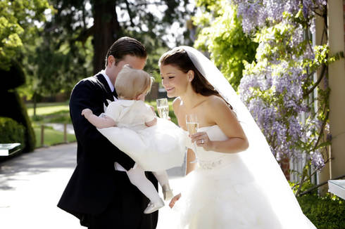 bride-and-groom-with baby-grove-hotel-we