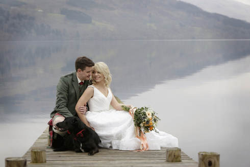 couple-by-loch-with-dog-scottish-highlands-wedding