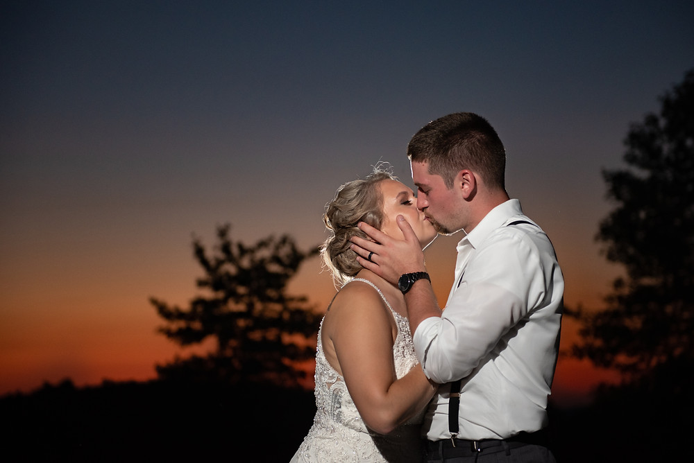 Bride and groom kissing at sunset; Pittsburgh wedding photography