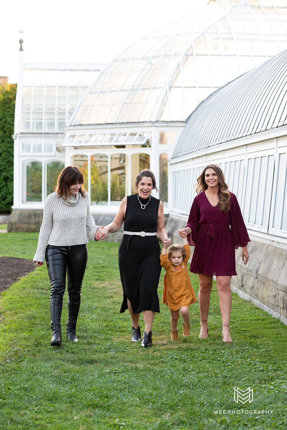 Family of girls walking and laughing at Phipps Conservatory