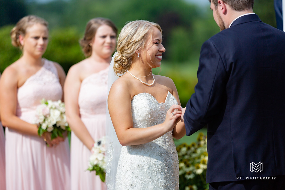 Bride and groom exchanging rings and laughing
