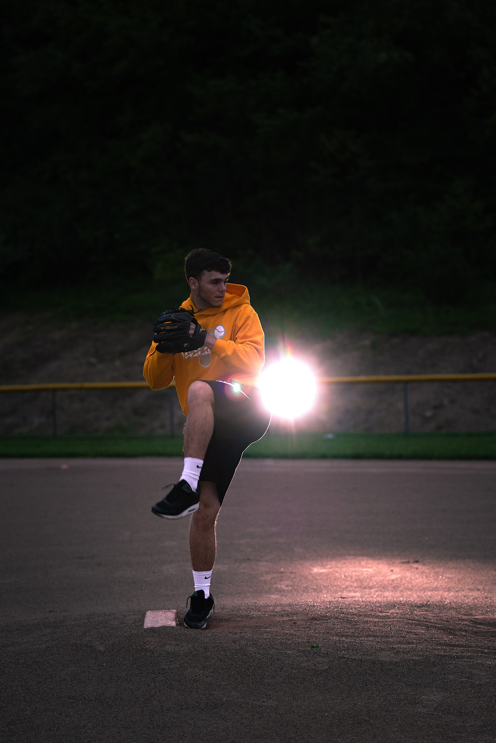 Senior guy photography session at night on the baseball field near Pittsburgh