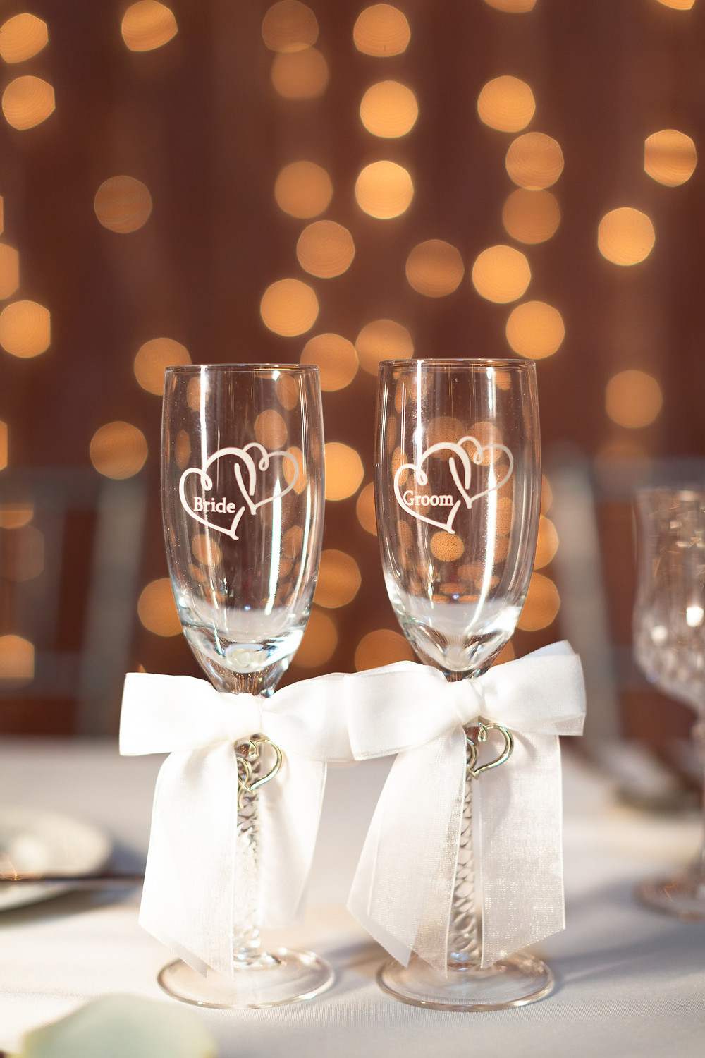 Bride and groom glasses on the head table at The Priory in Pittsburgh